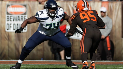 <p>               FILE - In this Oct. 13, 2019, file photo, Seattle Seahawks offensive tackle George Fant (74) plays against Cleveland Browns defensive end Myles Garrett (95) during the second half of an NFL football game in Cleveland. Fant, who is now with the New York Jets, spent most of his college days at Western Kentucky shooting basketballs and grabbing rebounds as a physical power forward with big-time hoop dreams. He had no idea then that football would ultimately be his path to stardom. (AP Photo/Ron Schwane, File)             </p>