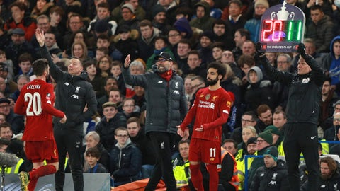 <p>               Liverpool's manager Jurgen Klopp, center, shouts out from the touchline as Liverpool's Adam Lallana, left, is substituted by Liverpool's Mohamed Salah during the English FA Cup fifth round soccer match between Chelsea and Liverpool at Stamford Bridge stadium in London Tuesday, March 3, 2020. (AP Photo/Ian Walton)             </p>