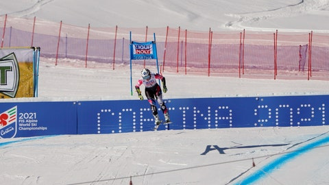 <p>               FILE - In this Jan. 20, 2019 file photo, Liechtenstein's Tina Weirather speeds down the course as a banner advertising the ski world championships in Cortina d'Ampezzo is seen in the background, during an alpine ski, women's World Cup super-G in Cortina D'Ampezzo, Italy. The Italian Winter Sports Federation (FISI) announced Sunday, May 24, 2020 that it would like to postpone next year's Alpine skiing world championships in Cortina until March 2022 in order to avoid the championships being canceled or shortened due to the fallout in Italy from the coronavirus pandemic. (AP Photo/Giovanni Auletta, file)             </p>
