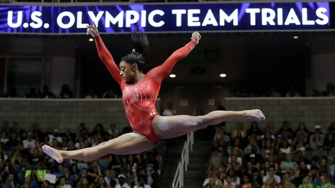 <p>               FILE - In this July 10, 2016, file photo, Simone Biles competes on the balance beam during the women's U.S. Olympic gymnastics trials in San Jose, Calif. At least 70 percent of U.S. Olympic sports organizations have applied for government loans in the coronavirus pandemic, underscoring the frailties within the world's most dominant Olympic sports system. (AP Photo/Gregory Bull, File)             </p>