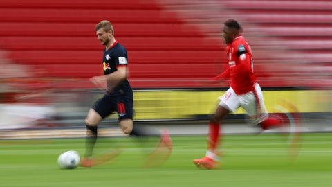 <p>               Leipzig's Timo Werner in action with 1.FSV Mainz 05's Moussa Niakhate during a German Bundesliga soccer match between FSV Mainz 05 and RB Leipzig in Mainz, Germany, Sunday, May 24, 2020.  (Kai Pfaffenbach/pool via AP)             </p>