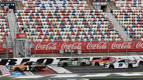 <p>               Kurt Busch (1) leads the pack as the green flag is waved at the start of the NASCAR Cup Series auto race at Charlotte Motor Speedway Sunday, May 24, 2020, in Concord, N.C. (AP Photo/Gerry Broome)             </p>