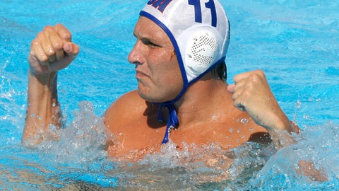 <p>               FILE - In this July 28, 2009, file photo, Jesse Smith, of the United States, reacts during a waterpolo quarterfinal match against Germany at the FINA Swimming World Championships in Rome. One way Smith is dealing with the coronavirus pandemic is through virtual speaking engagements with water polo clubs and teams all over the country, passing along what he has learned during a couple decades in the water. (AP Photo/Alessandra Tarantino, File)             </p>