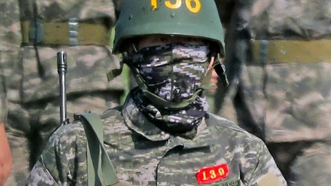 <p>               Tottenham Hotspur player Heung-min Son wearing a bulletproof helmet returns to a boot camp after finishing a rifle exercise at a Marine Corps firing range in Seogwipo on Jeju Island, South Korea, Wednesday, May 6, 2020. Son started last month a three-week period of military service in his native South Korea. He is fulfilling requirements of the military service exemption he earned by winning the gold medal for South Korea in the soccer tournament at the Asian Games in 2018. He would have been required by law to serve 21 months of service without the exemption. (Park Ji-ho/Yonhap via AP)             </p>