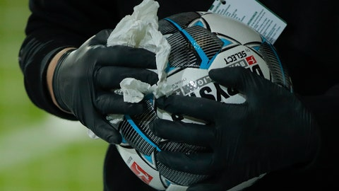 <p>               Staff members clean and disinfect the match balls after the the German first division Bundesliga soccer match, with Union Berlin facing FSV Mainz 05, being played without spectators because of the coronavirus, in Berlin, Germany, Wednesday May 27, 2020. (Odd Andersen / Pool via AP)             </p>