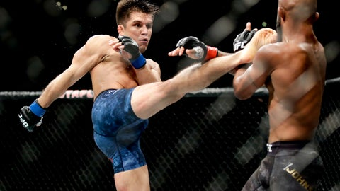 <p>               FILE - In this Aug. 4, 2018, file photo, Henry Cejudo, left, kicks Demetrious Johnson during their UFC flyweight title mixed martial arts bout at UFC 227 in Los Angeles. Cejudo is scheduled to fight Dominick Cruz at UFC 249 in Jacksonville, Fla., on Saturday, May 9, 2020. (AP Photo/Chris Carlson, File)             </p>