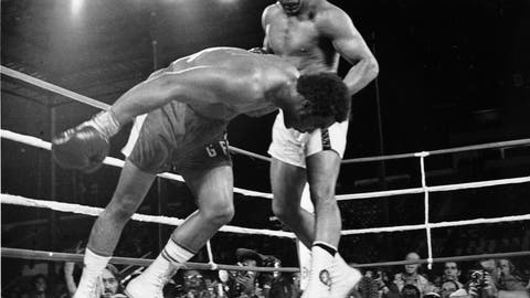 """<p>               FILE - In this Oct. 30, 1974, file photo, challenger Muhammad Ali, top, watches as defending world champion George Foreman goes down to the canvas in the eighth round of their WBA/WBC championship match in Kinshasa, Zaire. The 1996 film """"When We Were Kings"""" is a documentary of the bout known as the """"Rumble In The Jungle"""" between Ali and Foreman. The fight was a cultural milestone that ran far deeper than boxing. (AP Photo/File)             </p>"""