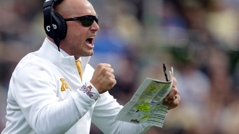 <p>               FILE - In this Sept. 28, 2019, file photo, Minnesota head coach P.J. Fleck celebrates a touchdown during the first half of an NCAA college football game against Purdue in West Lafayette, Ind. The coronavirus is preventing prospects from leaving home to visit campuses and is keeping college coaches from traveling to evaluate players across the country.  (AP Photo/Michael Conroy, File)             </p>