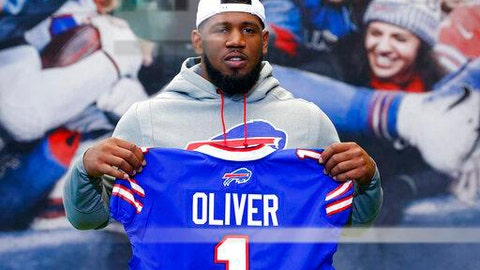 <p>               File-This April 27, 2019, file photo shows Buffalo Bills first round draft pick Ed Oliver posing for photographs following an NFL football news conference in Orchard Park N.Y.  Oliver was arrested Saturday, May 16, 2020, by police in the Houston area and charged with drunk driving and illegally carrying a gun. Montgomery County sheriff's deputies pulled Oliver over after receiving reports around 9 p.m. of someone driving recklessly in a construction area north of the city, local media outlets reported, citing jail and police records and statements from sheriff's officials. (AP Photo/Jeffrey T. Barnes, File)             </p>