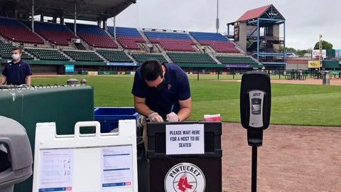 "<p>               A worker prepares for guests to dine on the field at McCoy Stadium, home of the Pawtucket Red Sox, in Pawtucket, Rhode Island, Wednesday, May 27, 2020. With the minor league baseball season on hold due to the coronavirus pandemic, the Triple-A affiliate of the Boston Red Sox had found another use for its home field. Starting next weekend, ""Dining on the Diamond"" will allow PawSox fans and others just longing for a taste of baseball to sample typical ballpark fare on the McCoy Stadium infield.(AP Photo/Jimmy Golen)             </p>"