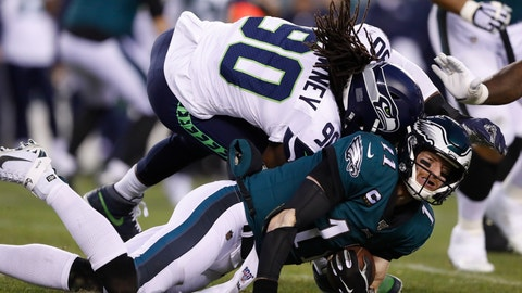 <p>               Seattle Seahawks' Jadeveon Clowney (90) hits Philadelphia Eagles' Carson Wentz (11) during the first half of an NFL wild-card playoff football game, Sunday, Jan. 5, 2020, in Philadelphia. (AP Photo/Julio Cortez)             </p>