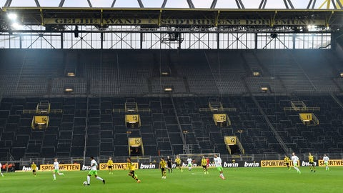 <p>               FILE - In this Feb. 18, 2017 file photo, players challenge for the ball in front of the empty south tribune because of a ban following fan trouble during the German Bundesliga soccer match between Borussia Dortmund and VfL Wolfsburg at Germany's biggest stadium in Dortmund, Germany. Bundesliga will now restart on May 16, 2020 when Dortmund will play the derby against Schalke at home without spectators due to the coronavirus outbreak. (AP Photo/Martin Meissner, file)             </p>