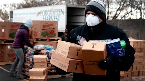 <p>               In a photo provided by Project Isaiah, Detroit Health Department worker helps to distribute packaged food as part of the Project Isaiah relief efforts bringing thousands of packaged meals to COVID-positive Detroit residents, Friday, May 1, 2020. (Project Isaiah via AP)             </p>