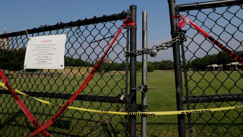 <p>               The gates of St. Edwards' Lewis-Chen Family Soccer Field are locked and marked closed due to the coronavirus outbreak, Tuesday, May 5, 2020, in Austin, Texas. In response to the economic impact of COVID-19, St. Edwards says they are cutting cut six sports programs including men's and women's tennis, men's and women's golf and men's soccer. (AP Photo/Eric Gay)             </p>
