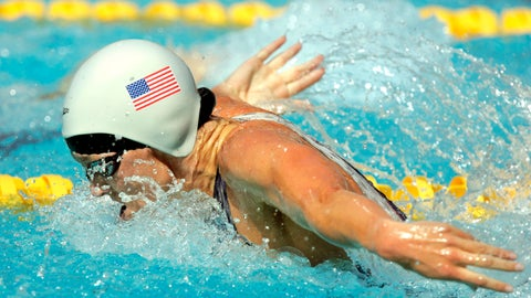 <p>               FILE - In this Aug. 14, 2004, file photo, Jenny Thompson swims during a qualifying heat of the 100 meter butterfly at the Olympic Aquatic Centre during the 2004 Olympic Games in Athens. One of America's greatest Olympic swimmers, Thompson is now on the front line of the fight against coronavirus as an anesthesiologist at the VA hospital in Charleston, South Carolina. (AP Photo/Mark J. Terrill, File)             </p>