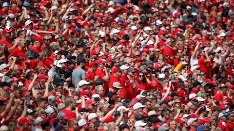 <p>               FILE - In this Sept. 7, 2019, file photo, Nebraska fans are shown in the first half of an NCAA college football game in Boulder, Colo. With each passing day it is becoming apparent the COVID-19 pandemic is going to make the goal to have all 130 major college football teams, spread across 41 states, start the upcoming season at the same time, and play the same number of games, difficult to achieve. (AP Photo/David Zalubowski, File)             </p>