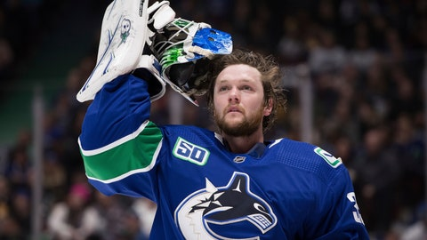 """<p>               FILE - In this Jan. 27, 2020 file photo, Vancouver Canucks goalie Thatcher Demko takes off his mask during a stoppage in play against the St. Louis Blues during the first period of an NHL hockey game in Vancouver, British Columbia. NHL players are debating the merits of quarantining away from family members as part of a potential resumption of the season.  Young and single, Demko said quarantining to play hockey wouldn't be a problem for him. """"I don't have too many roots,"""" the 24-year-old said. """"I've been living pretty much out of my car for the most part for the last six, seven years just going from place to place."""" (Darryl Dyck/The Canadian Press via AP, File)             </p>"""