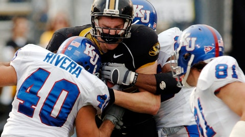 <p>               FILE - In this Nov. 25, 2006, file photo, Missouri receiver Chase Coffman, second left, is hit after a catch by Kansas' Mike Rivera (40), Russell Brorsen, right, and Darrell Stuckey during the first half of an NCAA college football game in Columbia, Mo. Kansas and Missouri are resuming their bitter Border War in football after the former Big 12 rivals agreed to a four-game series in which each school will play two home games beginning in September 2025. The fourth-longest rivalry in college football dates to 1891, but it has been on hiatus since Missouri departed for the Southeastern Conference.(AP Photo/L.G. Patterson, File)             </p>
