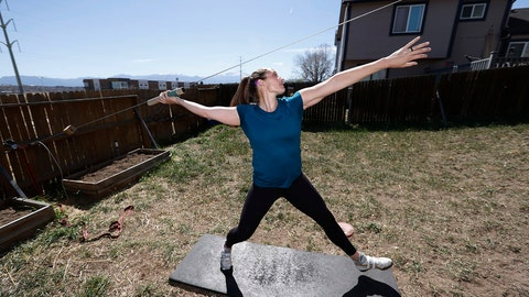 <p>               Kara Winger uses a cable system to simulate throwing a javelin as she trains outside her home in Colorado Springs, Colo., Wednesday, April 29, 2020. The renovated home of three-time Olympic javelin thrower Kara Winger now has all the training amenities she needs, including cable. No premium channels on this cable. It's just a basic wire she and her husband installed in the backyard to help her work on her technique. She throws a metal pipe along the angled cable to simulate javelin tosses. (AP Photo/David Zalubowski)             </p>