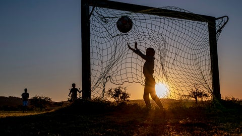<p>               Children play soccer on a meadow with makeshift goals in Obernhain near Frankfurt, Germany, Tuesday, May 5, 2020. Due to the coronavirus playgrounds in German were closed until last Monday. (AP Photo/Michael Probst)             </p>