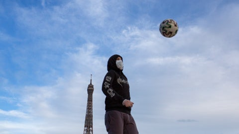 <p>               A young man wears a mask to protect against the spread of the coronavirus as he plays with a soccer ball along the Trocadero square close to the Eiffel Tower in Paris, Saturday May 2, 2020 in Paris. France continues to be under an extended stay-at-home order until May 11 in an attempt to slow the spread of the COVID-19 pandemic. (AP Photo/Rafael Yahgobzadeh)             </p>