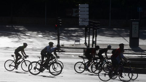 <p>               In this photo taken on Sunday May 3, 2020, a group of cyclists, many on racing bikes, ride down the Paseo de la Castellana boulevard in Madrid, Spain after Spaniards were able to go outdoors to do exercise for the second time in seven weeks since the lockdown began to battle the coronavirus outbreak. High-performance athletes were allowed to resume training this week but some reported being harassed by local residents who thought they were breaking confinement rules. (AP Photo/Paul White)             </p>