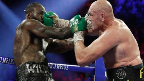<p>               Tyson Fury, of England, lands a right to Deontay Wilder during a WBC heavyweight championship boxing match Saturday, Feb. 22, 2020, in Las Vegas. (AP Photo/Isaac Brekken)             </p>