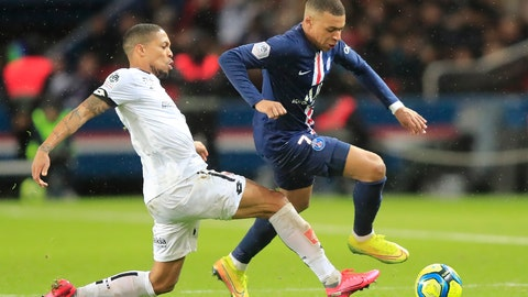 <p>               Dijon's Mickael Alphonse, left, and PSG's Kylian Mbappe challenge for the ball during the French League One soccer match between Paris-Saint-Germain and Dijon, at the Parc des Princes stadium in Paris, France, Saturday, Feb. 29, 2020. (AP Photo/Michel Euler)             </p>