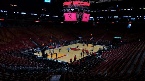 <p>               FILE - In this Oct. 23, 2019, file photo, the Miami Heat and the Memphis Grizzlies practice before an NBA basketball game in Miami, Fla. If so inclined, NBA teams like Miami, Orlando and Utah could all be back in the gym for voluntary workouts in small groups starting Friday when the league ban on such things expires. None of them will be reopening that day. There's a clear desire for basketball to resume but, perhaps mindful of how rushing back too quickly hurt other leagues around the world, the NBA seems to be taking very cautious baby steps back to the court. (AP Photo/Brynn Anderson, File)             </p>