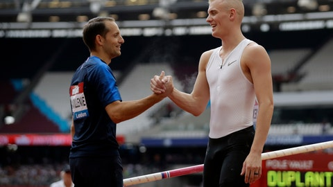 """<p>               FLE - In this July 21, 2018, file photo, second placed Renaud Lavillenie of France, left, shakes hands with winner Sam Kendricks at the men's pole vault event at the IAAF Diamond League athletics meeting in London. The three biggest names in men's pole vault will compete against each other from their own backyards, Sunday, May 3, 2020, in a rare sporting event during the coronavirus pandemic. Video links will connect world record holder Mondo Duplantis, world champion Sam Kendricks and former Olympic champion Renaud Lavillenie. World Athletics calls it """"The Ultimate Garden Clash"""" and will stream it on social media. (AP Photo/Matt Dunham, File)             </p>"""