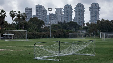<p>               In this Saturday, March 28, 2020 photo, a closed training soccer field is seen during lockdown following government measures to help stop the spread of the coronavirus in Tel Aviv, Israel. The once thrumming city of Tel Aviv, famed for its nightlife and bustling beachfront, has fallen eerily quiet due to Israel's tight movement restrictions to halt the spread of the coronavirus. (AP Photo/Oded Balilty)             </p>
