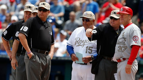 <p>               FILE - In this May 27, 2013, file photo, Kansas City Royals bench coach Chino Cadahia (15) and St. Louis Cardinals first base coach Chris Maloney (37) exchange line-ups with home plate umpire Rob Drake (30) before a baseball game at Kauffman Stadium in Kansas City, Mo.  The exchange of lineup cards would be eliminated, fielders will be encourages to space themselves from baserunners between pitches and managers and coaches must wear masks while in the dugouts under Major League Baseball's proposed operations manual for starting the coronavirus-delayed season. (AP Photo/Orlin Wagner, File)             </p>