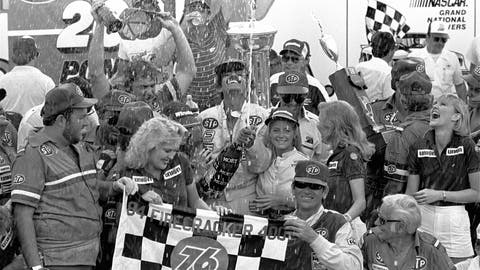 <p>               FILE - In this Wednesday, July 4, 1984, file photo, Firecracker 400 winner Richard Petty showers the crowd with champagne in Victory Lane at Daytona International Speedway in Daytona Beach, Fla. It's weeknight racing at Darlington as NASCAR's comeback from the coronavirus continues with its first Wednesday race in 36 years on May 20, 2020. (AP Photo/Jann Zlotkin, File)             </p>