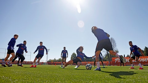 <p>               In this photo provided by Atletico Madrid, team players take part in the first group training session in Madrid, Spain, on Monday May 18, 2020. All Spanish league clubs can begin group training sessions this week despite stricter lockdown restrictions remaining in place in parts of Spain because of the coronavirus pandemic. (Atletico de Madrid via AP)             </p>