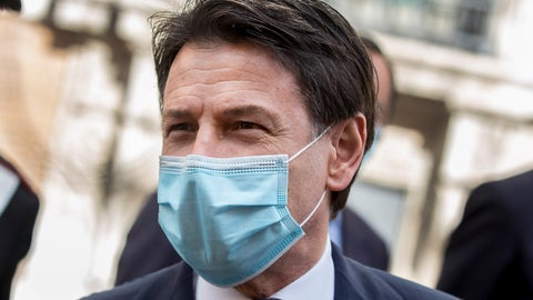 <p>               Italian Premier Giuseppe Conte leaves after addressing the Senate, in Rome, Thursday, April 30, 2020. Italy is in its eighth week of national lockdown to cope with COVID-19 emergency with some partial easing of restrictions on everyday life slated to take effect on Monday, with lifting of yet more limits set for later in coming weeks, on condition the rate of contagion doesn't sharply start rising again. (Roberto Monaldo/LaPresse via AP)             </p>