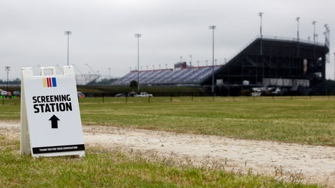 <p>               A sign directs people to a screening station outside Darlington Raceway Sunday, May 17, 2020, in Darlington, S.C. NASCAR, which has been idle since March 8 because of the coronavirus pandemic, makes its return with the Real Heroes 400 Nascar Cup Series auto race Sunday. (AP Photo/Brynn Anderson)             </p>