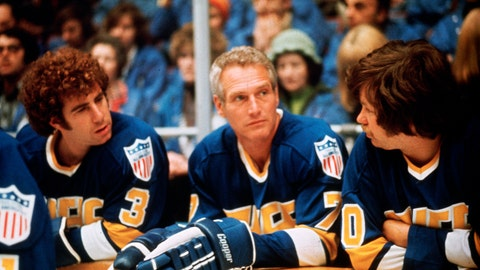 """<p>               This undated photo provided Courtesy of Universal Pictures shows actors Jerry Houser, left, and Paul Newman, center, in a scene from the movie """"Slap Shot."""" """"Slap Shot"""" was No. 5 in The Associated Press' Top 25 favorite sports movies poll.  (Courtesy of Universal Pictures via AP)             </p>"""