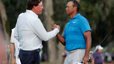 <p>               FILE - In this May 10, 2018, file photo, Phil Mickelson, left, and Tiger Woods shake hands after the first round of the Players Championship golf tournament in Ponte Vedra Beach, Fla. Woods and Mickelson are ready for a made-for-TV rematch at a time when fans are craving live action. And this time, they'll have company. Turner Sports says quarterbacks Tom Brady and Peyton Manning will join them for a two-on-two match sometime in May. Missing from the announcement were such details as when and where the match would be played, except that tournament organizers would work with government and health officials to meet safety and health standards. (AP Photo/Lynne Sladky, File)             </p>