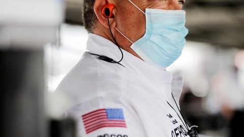 <p>               A NASCAR official wears a face mask because of the coronavirus pandemic as he works inside the garage before the NASCAR Xfinity series auto race Tuesday, May 19, 2020, in Darlington, S.C. NASCAR has developed a health plan approved by officials in both South Carolina and North Carolina and scheduled seven races over 11 days at two tracks. (AP Photo/Brynn Anderson)             </p>