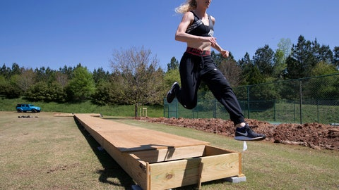 <p>               FILE - In this April 14, 2020, file photo, Olympic pole vaulting silver medalist Sandi Morris runs on the vaulting pit she is building with her father in Greenville, S.C. The coronavirus crisis has forced many athletes to be creative as they try to continue their training. (AP Photo/John Bazemore, File)             </p>