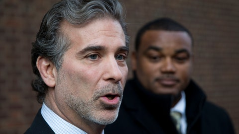 <p>               FILE - In this Nov. 19, 2014, file photo, co-lead players' lawyer Christopher Seeger, left, and client former NFL player Shawn Wooden speak with members of the media after a hearing on the proposed NFL concussion settlement outside of the U.S. Courthouse in Philadelphia. After several years of infighting over $112 million in legal fees in the NFL concussion case, a federal appeals court has approved a plan to give nearly half the money to Seeger's firm. The decision Thursday, May 7, 2020, grants New York-based Seeger Weiss over $51 million, more than 10 times the amount of any other firm, including the lawyers who filed the first cases in 2012. (AP Photo/Matt Rourke, File)             </p>