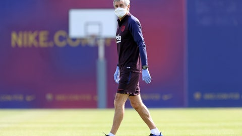 <p>               In this photo provided by FC Barcelona, Barcelona's coach Quique Setien watches his players doing a training session in Barcelona, Spain on Friday May 8, 2020. Soccer players in Spanish player returned to train for the first time since the country entered a lockdown nearly two months ago because of the coronavirus pandemic. (Miguel Ruiz/FC Barcelona via AP)             </p>