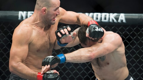 <p>               FILE - In this Sept. 14, 2019, file photo, Glover Teixeira, left, fights Nikita Krylov during their light heavyweight match at UFC Fight Night in Vancouver, British Columbia. Teixeira dominated Anthony Smith and finally stopped him with punches early in the fifth round Wednesday night, May 13, 2020, earning an upset victory to cap the UFC's second show since returning to action amid the coronavirus pandemic. (Jonathan Hayward/The Canadian Press via AP, File)             </p>