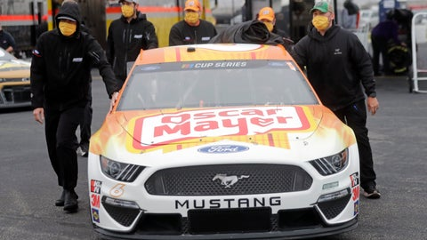 <p>               Crew members push the car of driver Ryan Newman as they wear masks as required for safety measures due to the coronavirus pandemic before the Toyota 500 NASCAR Cup Series auto race Wednesday, May 20, 2020, in Darlington, S.C. (AP Photo/Brynn Anderson)             </p>
