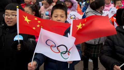 <p>               FILE - In this Feb. 27, 2018, file photo, a child waves a Chinese national flag and an Olympic flag during a ceremony to mark the arrival of the Olympic flag and start of the flag tour for the Winter Olympic Games Beijing 2022 at a section of the Great Wall of China on the outskirts of Beijing. Uncertainty surrounds how the postponed Tokyo Olympics will be held next year in the midst of the coronavirus. The same questions permeate three mega-events that will be staged in China within a year after the Tokyo Games close. (AP Photo/Ng Han Guan, File)             </p>