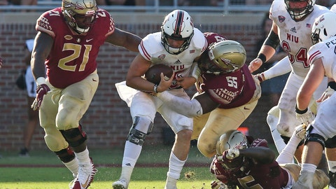 <p>               FILE - In this Saturday, Sept.22, 2018, file photo, Northern Illinois quarterback Marcus Childers is sacked by Florida State's Marvin Wilson (21), Fredrick Jones (55) and Dontavious Jackson during an NCAA college football game, in Tallahassee Fla. The road trip to Tallahassee came with a $1.6 million payout to NIU. (AP Photo/Steve Cannon, File)             </p>