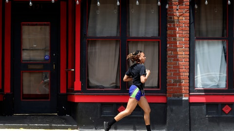 <p>               FILE - In this Thursday, May 7, 2020, file photo, a person jogs past a closed nightclub in St. Louis. Running is seeing an increase in participation since the coronavirus outbreak began taking off in the United States. (AP Photo/Jeff Roberson, File)             </p>