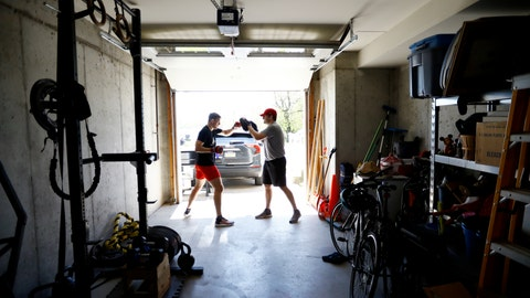 <p>               Fighter Kyle Daukaus, left, trains with his brother Chris Daukaus in their garage, Saturday, May 2, 2020, in Philadelphia. Kyle, a rising star in the regional MMA promotion Cage Fury Fighting Championships, is still chasing his dream of getting the call to fight for UFC despite the coronavirus pandemic. (AP Photo/Matt Slocum)             </p>