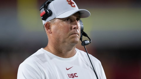 <p>               FILE - In this Sept. 31, 2019, file photo, Southern California head coach Clay Helton watches an NCAA college football game against Fresno State in Los Angeles. The Pac-12 has discussed the possibility of moving to an 11-game, all-conference schedule this year amid the unprecedented uncertainty of the coronavirus pandemic, Helton says. Stanford's David Shaw also says he does not necessarily agree with NCAA President Mark Emmert's belief that college campuses should be open for college sports to resume. (AP Photo/Kyusung Gong, File)             </p>