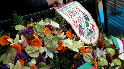 <p>               FILE - In this Friday, May 29, 2015 file photo, a man holds an original banner from the 1985 match during a commemoration at the King Boudouin (formerly the Heysel) Stadium in Brussels. Friday, May 29, 2020 marks 35 years since 39 victims lost their lives during a European Cup football match between Liverpool and Juventus due to a surge of rival supporters resulting in a collapsed wall. (AP Photo/Virginia Mayo, File)             </p>